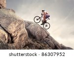 cyclist climbing on a rock | Shutterstock . vector #86307952