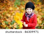 Little Girl In A Red Coat At...