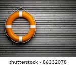 lifebuoy attached to a wooden... | Shutterstock . vector #86332078