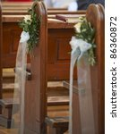 Church bench decoration for wedding - stock photo