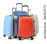 Luggage consisting of four suitcases isolated on white - stock photo
