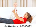 smiling mother and adorable... | Shutterstock . vector #86365099