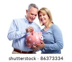 happy senior couple with piggy... | Shutterstock . vector #86373334