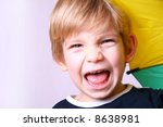 Kid with a colorful umbrella - stock photo