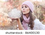 Young beautiful woman wearing winter clothing in the snow - stock photo
