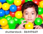Boy Playing In Ball Land