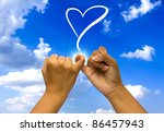 two coupled hands on blue sky. | Shutterstock . vector #86457943