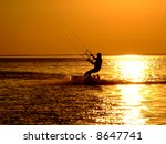 Silhouette Of A Kitesurf On A...