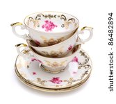 stack of antique tea cups on... | Shutterstock . vector #86482894