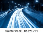 rush hour traffic at night, light trails on the modern city - stock photo