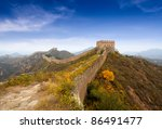 the great wall of china against a blue sky in autumn - stock photo