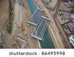 Bridge construction over canal - stock photo