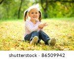 little girl is sitting on green ... | Shutterstock . vector #86509942