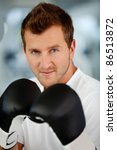 Male boxer wearing boxing gloves at the gym - stock photo