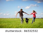 young happy couple running on a ... | Shutterstock . vector #86532532