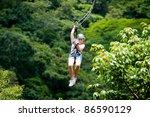 ziplining in costa rica | Shutterstock . vector #86590129