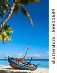 Boat On The Coast. Palm....