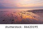 Stones On The Beach At Sunset
