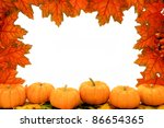 Autumn frame of red maple leaves and pumpkins - stock photo
