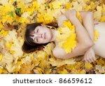 naked girl lies in maple leaves ... | Shutterstock . vector #86659612