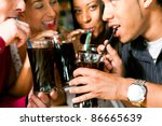 four friends drinking soda in a ... | Shutterstock . vector #86665639