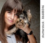 Cute Young Girl With Her Yorki...
