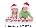 Happy smiling christmas hat kids holding paper santas - stock photo