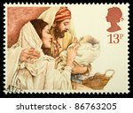 Small photo of UNITED KINGDOM - CIRCA 1984: A stamp printed in the United Kingdom shows a Christmas postage stamp with Mary, Joseph and Baby Jesus, circa 1984