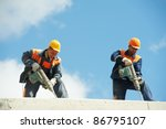 Two Builder Workers With...