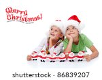 Happy christmas kids dreaming about santa - looking to copy space - stock photo