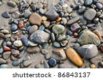 Polished Stones On A Beach In...