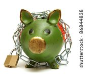 A conceptual shot of an isolated piggy bank that is bound by chains to give representation to protecting your money. - stock photo