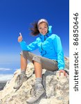 Hiker woman at mountain top summit enjoying view giving success thumbs up sign smiling happy of her hiking achievement. Beautiful happy smiling female hiker on the top of volcano Teide, Tenerife Spain - stock photo