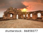 in ruins of the great wall watch tower at sunset - stock photo