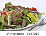 beef sirloin strip with black pepper seasoning  mixed with green salad - stock photo