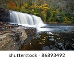 Hooker Falls Autumn Waterfalls DuPont State Park Forest Fall Foliage nature scene natural North Carolina Blue Ridge Mountains outdoors landscape - stock photo