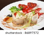 fillet of pikeperch stuffed with trout fish with baked pepper, tomato and leek - stock photo