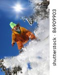 snowboarder jumping against... | Shutterstock . vector #86909903