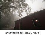 House involved in mist - stock photo