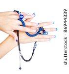 isolated body part shot of beautiful young woman's manicured hands with fancy blue beads on white - stock photo