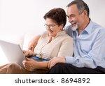 senior couple on laptop   Shutterstock . vector #8694892