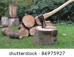 Axe And Wooden Tree Logs Ready...