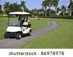 Empty Golf Cart Sitting On A...
