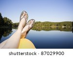 Legs Resting On A Paddle Boat...