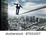 Business Man Balancing On The...