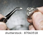 hands holding diamond ring with ... | Shutterstock . vector #87063518