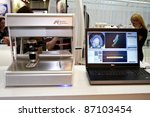 Small photo of MOSCOW - APRIL 27: NobelProcera Optical 3d scanner and a model of teeth at the international exhibition of the dental professionals and industry on April 27, 2011 in Moscow