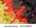 abstract background with artificial flowers - stock photo