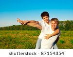 happy family in a meadow | Shutterstock . vector #87154354