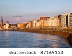 View of building facades of Dusseldorf embankment at the sunset, Germany - stock photo